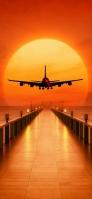 夕日に向かってフライトする飛行機 iPhone 11 Pro Max スマホ壁紙・待ち受け