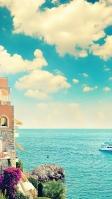 快晴時の綺麗な空と海と建物 iPhone SE (第2世代) スマホ壁紙・待ち受け
