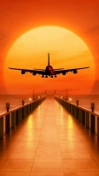綺麗な夕日と飛行する飛行機 iPhone SE (第2世代) スマホ壁紙・待ち受け