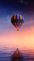 夕暮れの空とカラフルな気球 iPhone SE (第2世代) スマホ壁紙・待ち受け