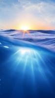 青い海と黄色い太陽 iPhone SE (第2世代) スマホ壁紙・待ち受け