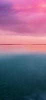 ピンクの空 青の海 iPhone 12 スマホ壁紙・待ち受け
