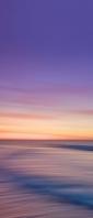 紫とオレンジのグラデーションの空 流れる土地 Xperia 10 II Androidスマホ壁紙・待ち受け