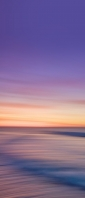 紫とオレンジのグラデーションの空 流れる土地 Xperia 10 III Androidスマホ壁紙・待ち受け