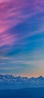 ピンク・青のグラデーションの空 雪山 Galaxy A32 5G 壁紙・待ち受け